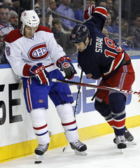Montreal Canadiens Prust fights for the puck with New York Rangers Staal during their NHL game in New York