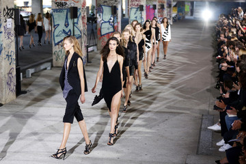 Models present creations by designer Anthony Vaccarello as part of his Spring/Summer 2015 women's ready-to-wear collection during Paris Fashion Week