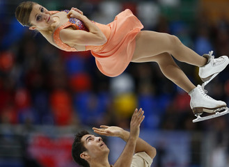Canada's Lawrence and Swiegers perform during the pairs short program at the ISU Grand Prix of Figure Skating Rostelecom Cup in Moscow
