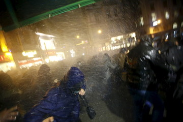 Riot police use water cannons to disperse protesters during an anti-government protest in Istanbul, Turkey