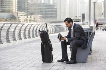 businessman with his suitcase in Dubai Marina