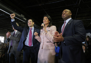 U.S. Republican presidential candidate Marco Rubio reacts as South Carolina Governor Nikki Haley speaks while U.S. Senator Tim Scott looks on during a campaign event at Swamp Rabbit Crossfit in Greenville