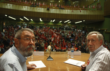 Union leaders pose before a union rally on the eve of a nationwide general strike in Madrid