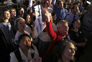 Supporters cheer at a election night rally for Republican Wisconsin Governor Walker in Waukesha
