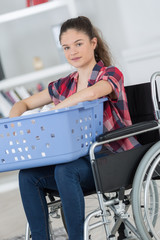 disabled woman doing laundry at home