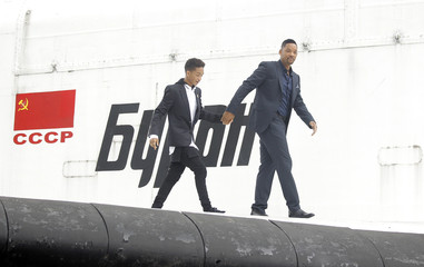 """U.S. actor Will Smith and his son Jaden Smith poseduring a photo call to promote their latest movie """"After Earth"""" on the mainplane of the Buran space shuttle in Moscow"""