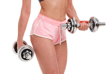 Sexy young fitness woman doing workout with dumbbells, isolated on white background