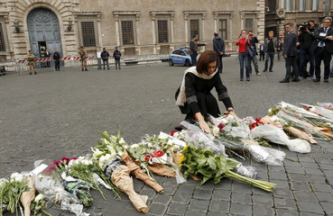Italian Lower House President Laura Boldrini lays flowers, in sympathy with the victims of the Paris attacks, in front of the French embassy in Rome