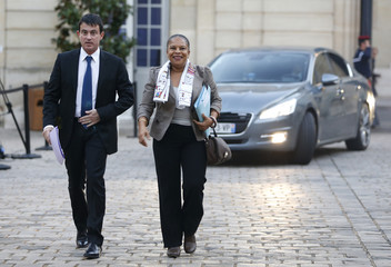 French Interior Minister Valls and Justice Minister Taubira arrive for a meeting about violence in Corsica at Matignon Hotel in Paris