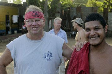 Inmate poses for a picture with Mayne as crew members of Florida-based shipwreck salvage company Aqua Quest International Captain Mayne and Cook chat at jail in Puerto Lempira