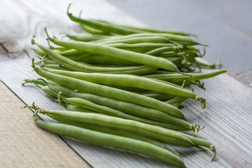 Bunch of fresh beans on the wooden background