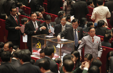 Delegates cast their vote during voting session at the 11th national congress of the communist party in Hanoi