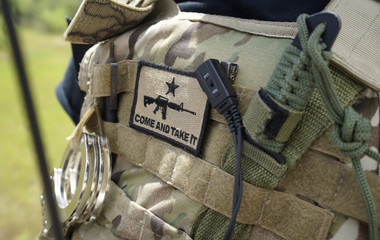 "A patch that says ""come and take it"" is seen on the flak jacket worn by member of the ""Patriots"" near the U.S.-Mexico border outside Brownsville, Texas"