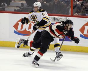 Ottawa Senators' Foligno collides with Boston Bruins' McQuaid during their NHL hockey game in Ottawa