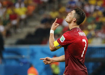 Portugal's Ronaldo reacts after missing a scoring opportunity during their 2014 World Cup G soccer match against the U.S. at the Amazonia arena in Manaus