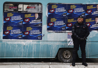 A European Union policeman secures an area near a polling station in the northern part of the ethnically-divided town of Mitrovica