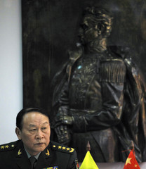 China's Defense Minister Liang listens to his Colombian counterpart Rodrigo Rivera during a visit to the Defense Ministry in Bogota