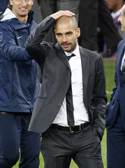 Barcelona's coach Guardiola looks at his players at the end of their Spanish first division soccer match against Valladolid in Barcelona
