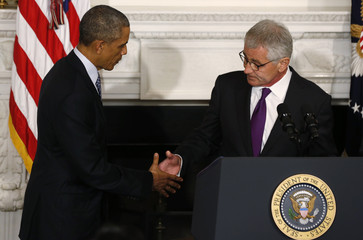 U.S. President Obama greets Defense Secretary Hagel after announcing Hagel's resignation at the White House in Washington
