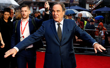 "Director Oliver Stone poses as he arrives for the gala screening of the film ""Snowden"", during the 60th British Film Institute (BFI) London Film Festival at Leicester Square in London"