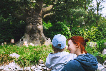 Family is having fun at amusement park Efteling, Netherlands.