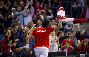 Canada's Raonic celebrates beating Italy's Seppi in their Davis Cup quarter-final tennis match in Vancouver