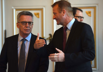 German Interior Minister Thomas de Maiziere talks with the Interior Minister of North-Rhine Westphalia Ralf Jaegermin Aachen