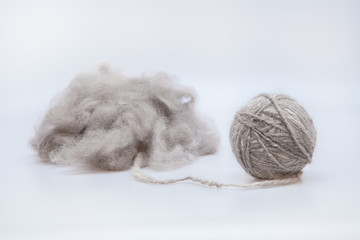 Persian cat raw wool yarn coiled into a ball