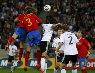 Spain's Puyol heads to score against Germany during their World Cup semi-final soccer match at Moses Mabhida stadium in Durban