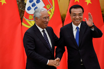 Portuguese Prime Minister Antonio Costa shakes hands with Chinese Premier Li Keqiang during a joint news conference at the Great Hall of the People in Beijing