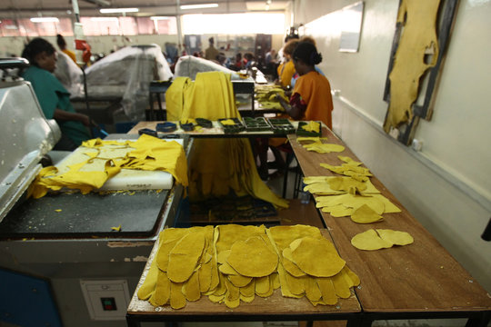 Pieces of designed leather are arranged on a working table at the Pittards world class leather manufacturing company in Ethiopia's capital Addis Ababa