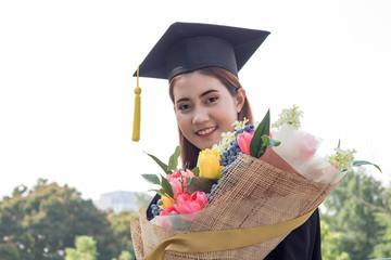 happy graduate  flower bouquet in hand with in the garden