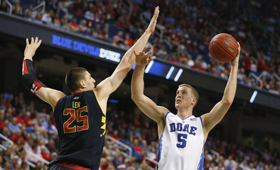 Duke Blue Devils Plumlee works to shoot around Maryland Terrapins Len during their ACC Championship game in Greensboro