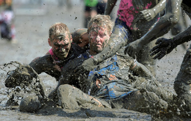 "Participants fight for the ball during a handball match at the so called ""Wattoluempiade"" (Mud Olympics) in Brunsbuettel"