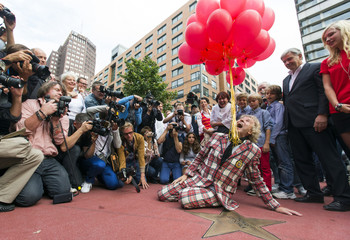 German entertainer Thomas Gottschalk releases balloons at his star at the Boulevard of Stars in Berlin