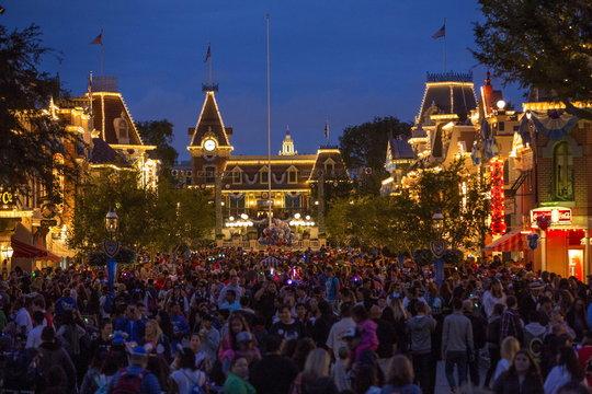 People are seen along Main Street during Disneyland's Diamond Celebration in Anaheim, California