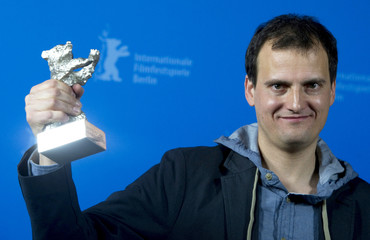 Wojciech Staron poses with the Silver Bear award for Outstanding Artistic Achievement at 61st Berlinale International Film Festival in Berlin