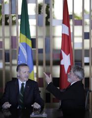 Brazil's President da Silva and Turkey's Prime Minister Erdogan attend a signing ceremony at Itamaraty Palace in Brasilia