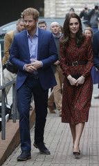 Britain's Kate Duchess of Cambridge and Prince Harry arrive for a visit to The Mix in London