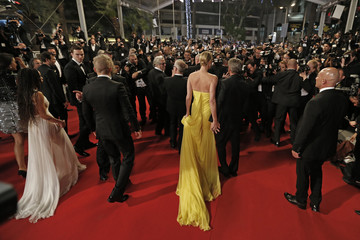 """Cast member Charlize Theron and actor Sean Penn leave after the screening of the film """"Mad Max: Fury Road"""" out of competition at the 68th Cannes Film Festival in Cannes"""