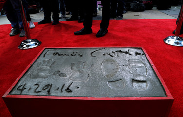 The hand, footprints and signature of director Coppola are pictured in cement following a ceremony in the forecourt of the TCL Chinese theatre in Hollywood