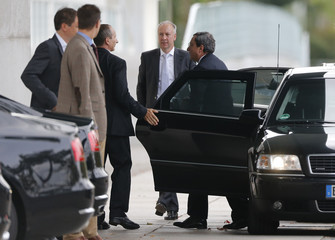 European Central Bank President Draghi arrives to meet German Chancellor Merkel at Chancellery in Berlin