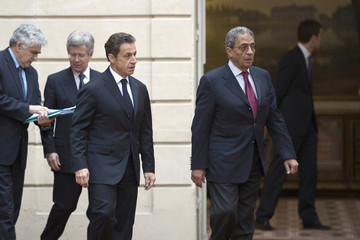 France's President Sarkozy speaks to Arab League Secretary-General Amr Moussa in Paris