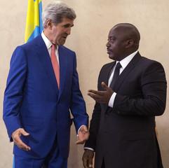 President of DRC Joseph Kabila speaks with U.S. Secretary of State John Kerry at Palais de la Nation in Kinshasa
