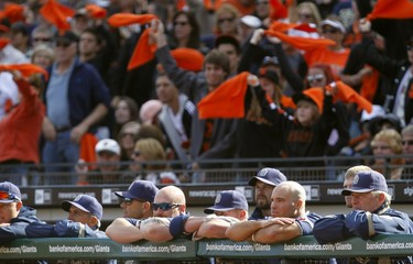 San Diego Padres players watch action against the San Francisco Giants in San Francisco