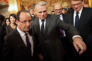 France's President Hollande and Prime Minister Ayrault leave after a news conference at the Elysee Palace in Paris