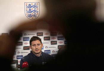 England's Lampard listens to questions during a news conference at the Parken Stadium in Copenhagen