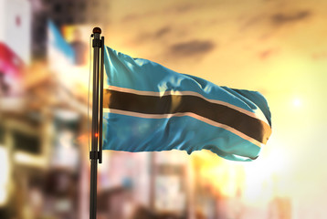 Botswana Flag Against City Blurred Background At Sunrise Backlight
