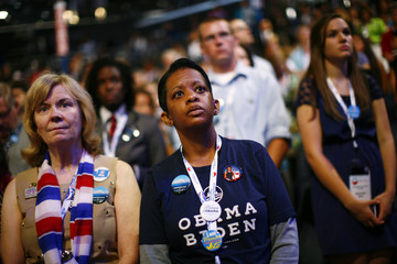 Delegates stand on the convention floor during the first day of the Democratic National Convention in Charlotte