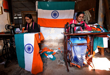 Workers stitch Indian national flags at a workshop ahead of Republic Day celebrations in Guwahati
